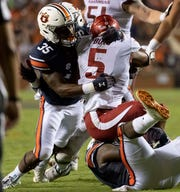 Auburn linebacker Zakoby McClain (35) stops Arkansas running back Rakeem Boyd (5) on a run during the second half of an NCAA college football game, Saturday, Sept. 22, 2018, in Auburn, Ala.