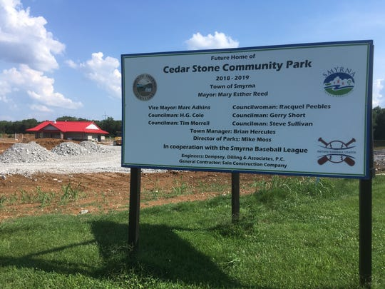 This sign shows where  Cedar Stone Community Park will open by late October on Morton Lane near Stewarts Creek schools. The park will provide four synthetic turf baseball fields with LED lighting, Smyrna Town Manager Brian Hercules says. Crews have already completed a concession stand building with bathrooms in area behind sign.