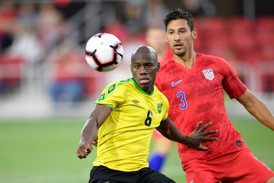 Jamaica forward Dever Orgill (6) and U.S. defender Omar Gonzalez go for the ball during an international friendly soccer match June 5 in Washington. Jamaica won 1-0.
