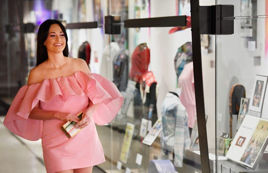 Kacey Musgraves smiles as she looks over her new exhibit at the Country Music Hall of Fame on July 1.