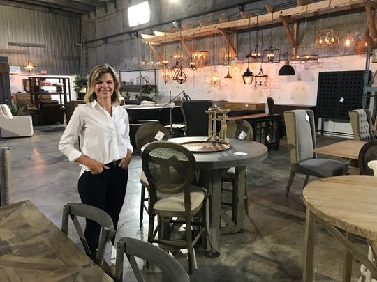Sara Young, owner of Sara Sells, shows off her warehouse where she holds her popular monthly sales.