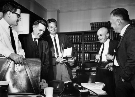 Five attorneys for a group of citizens seeking reapportionment of the Tennessee Legislature work over law books and briefs before their federal court hearing in May of 1962. They are Hobart Atkins of Knoxville, left, Harris Gilbert and Z.T. Osborn Jr., both of Nashville, Walter Chandler of Memphis and C.R. McClain of Knoxville.