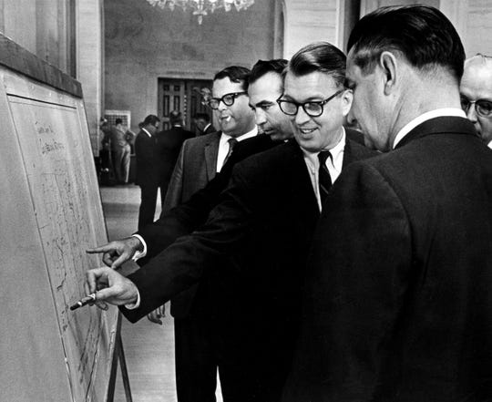 Sens. Ward Crutchfield, left, Frank Gorrell, Lewis Taliaferro and Leland Carter look over a reapportionment map during a May 1965 special legislative session.