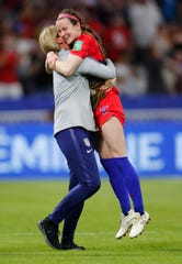 United States midfielder Rose Lavelle (16) celebrates with Jill Ellis after defeating England during semi-final play in the FIFA Women's World Cup France 2019 soccer tournament at Stade de Lyon.