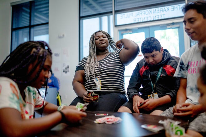 Camaraelle Milord, 17, plays a game with friends at the Boys and Girls Club in Immokalee on April 9, 2019. Milord spends many days after school at the facility doing homework and spending time with peers.