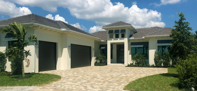 An exterior view of the new Caprina model, now available for viewing daily in the Peninsula at Treviso Bay.