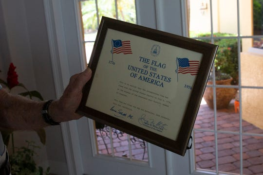 Thomas J. Marshall shows the certificate that came with his flag, Tuesday, July 2, 2019, during an interview at his home in East Naples.