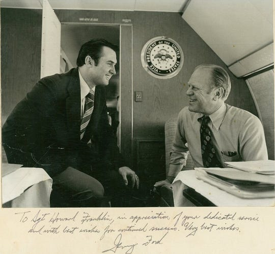 Howie Franklin (left), who served as a crewmember on Air Force One, laughs with President Gerald Ford. Franklin is the only flight steward who's worked for five U.S. Presidents: Ford, Jimmy Carter, Ronald Reagan, George H. W. Bush and Bill Clinton. Franklin spoke at the Naples Airport on Wednesday, July 3, 2019.