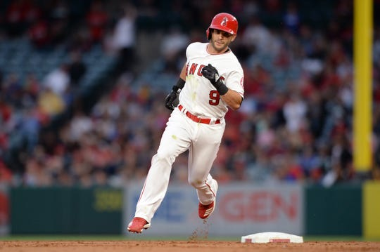 Jun 25, 2019; Anaheim, CA, USA; Los Angeles Angels second baseman Tommy La Stella (9) rounds the bases after hitting an inside-the-park home run during the first inning against the Cincinnati Reds at Angel Stadium of Anaheim.