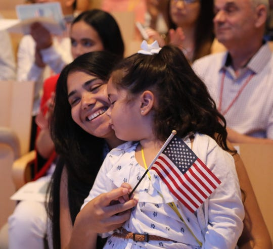 Thalia Del Carmen Malol with her four year old daughter Lia came to the US from the Dominican Republic and today was sworn in as a US citizen. Independence Day came a few days early when fifty two immigrants became U.S. citizens at a naturalization ceremony. The ceremony was the first time citizens have been naturalized  at the National 9/11 Memorial and Museum. The event took place in lower Manhattan on July 2, 2019.