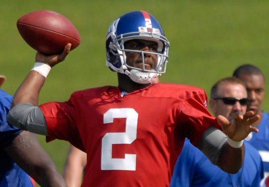 New York Giants' Anthony Wright passes the ball at the Giants football training camp in Albany, N.Y. on Saturday, July 26, 2008. (AP Photo/Tim Roske)