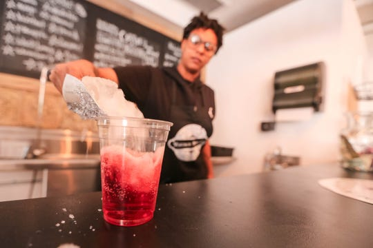 Barista Justine Branham makes an Italian soda at Main Street Vintage Mercado on Main Street and Las Cruces Avenue in Downtown Las Cruces on Tuesday, July 2, 2019.