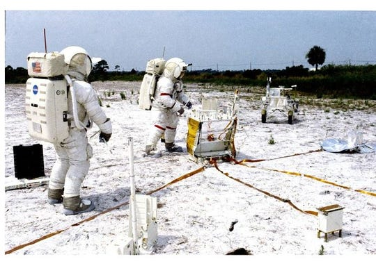 Edgar Mitchell, left, and Alan Shepard participate in lunar surface simulation training at the Kennedy Space Center, July 1970.