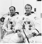 This 1970 photo of astronauts Alan B. Shepard Jr. (right), commander, and Edgar D. Mitchell, lunar module pilot, are suited up for a manned altitude run in the Apollo 14 Lunar Module.