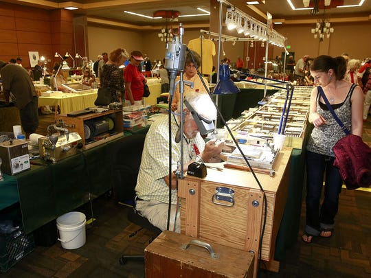 Jim Williamson of Earth Works of Santa Fe works on a ring during the 2016 San Juan County Gem and Mineral Show at the Farmington Civic Center. This year's event takes place this weekend at McGee Park.