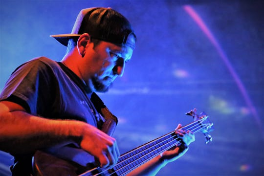 Bassist Josh Archibeque performs with Sub Horizon during a July 1 rehearsal at the Totah Theater.