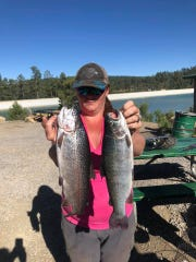 Two fish are better than one, according to this happy person who reeled in two decent sized fish at Grindstone Lake.