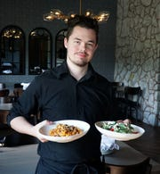 Bar Verona server Jordan Brooks with the Commerce Township restaurant's pasta Giuseppe Campanelle and Mediterranean salad.