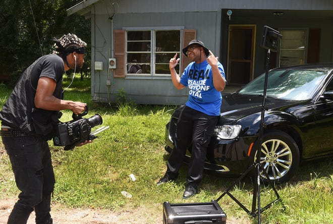 """2K Thomas, CEO of 2K Films of Baton Rouge, shoots a video of Vernon Wiggins, also known as V-Lo the Maestro, Saturday afternoon representing the town of Washington. The video, called """"Whoa Town Part Two,"""" pays homage to his hometown, Washington."""
