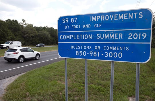 Road construction signs are still up along State Road 87 in Santa Rosa County on Tuesday. The project, which started in August 2002, is expected to be completed by mid-July.
