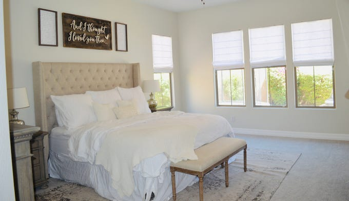 The Master bedroom is a serene spot that looks out to the backyard.
