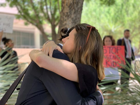 Scott Warren hugs his partner outside the Tucson federal courthouse on July 2,  2019, after the U.S. government announced it would seek a retrial against him on harboring charges.
