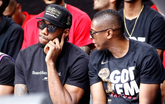 Kawhi Leonard tries to listen to Raptors President Masai Ujiri during a rally at Toronto City Hall.