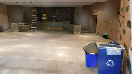 Furniture is removed from the inside of the Tempe City Council chambers prior to construction starting.