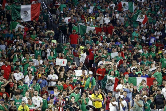 Mexico fans wave Mexican flags during the 2017 Gold Cup quarterfinal in 2017.