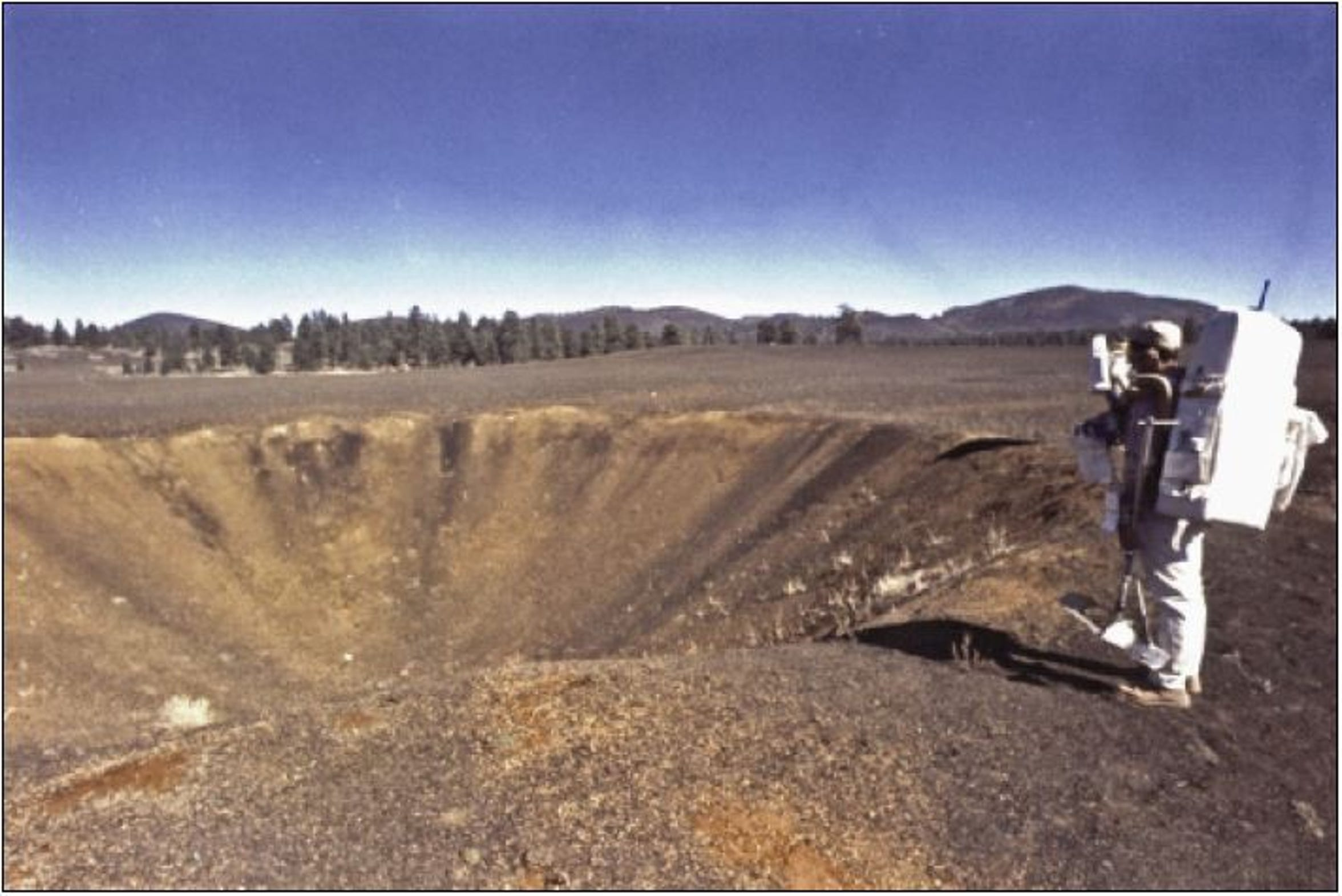 "Astronauts Harrison ""Jack"" Schmitt and Eugene ""Gene"" Cernan stand on the rim of a crater during training in northern Arizona."