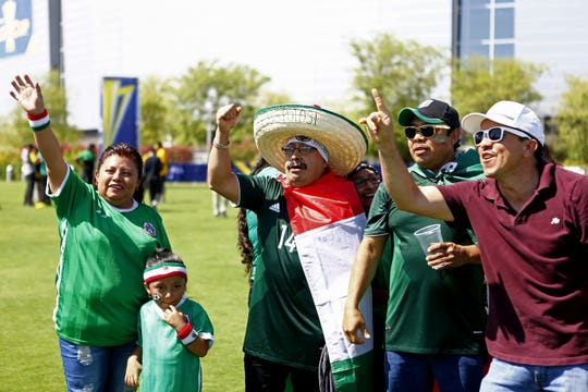 Mexico fans dressed in red, green and white chant during pregame activities. University of Phoenix Stadium in Glendale hosted two CONCACAF Gold Cup quarterfinal soccer matches: Mexico vs. Honduras and Jamaica vs. Canada.