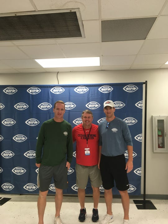 Lebanon High football coach Gerry Yonchiuk rubbed shoulders with Peyton and Eli Manning at the Manning Passing Academy in Louisiana over the weekend.