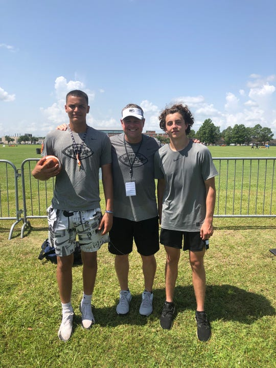 Lebanon High football coach Gerry Yonchiuk, center, with Lebanon quarterback Isaiah Rodriguez, left, and Cedar Crest QB Chris Danz at the Manning Passing Academy.