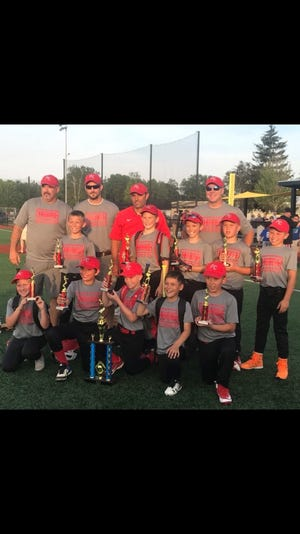 Port Clinton's 10-under baseball team earned a conference championship.