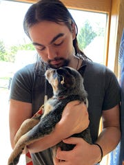 Noah Deninger holds Cleo, who was adoptedfrom Compassionate Animal Rescue Efforts of Dutchess County in Wappingers Falls.