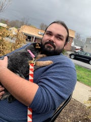 Wilfrido Deninger holds Cleo, who was adoptedfrom Compassionate Animal Rescue Efforts of Dutchess County in Wappingers Falls.