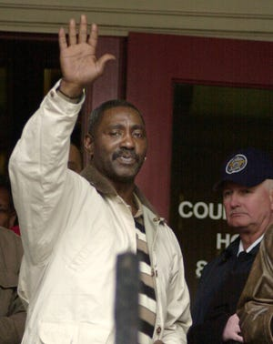 Leon Wright exits the York County Courthouse in York, Pa., Thursday, March 13, 2003, after he and another man, Stephen Freeland, were found guilty of second-degree murder in the 1969 race-riot slaying of Henry Schaad, a white police officer. Wright, 54, is out on bail until sentencing. (AP Photo/Brad C. Bower)