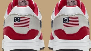 Nike is pulling a flag-themed tennis shoe after former NFL quarterback Colin Kaepernick complained to the shoemaker.