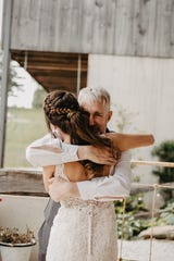 Kayla Linden, of Windsor, hugs her father Kevin Linden prior to her wedding in Airville May 25.