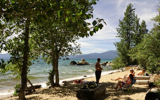 Beachgoers at Creek Beach, a clothing optional beach on Lake Tahoe's east shore. Shown on July 1, 2019.