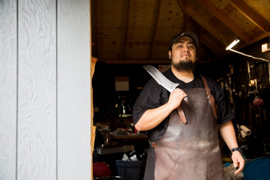 "Josh Navarrete, winner of History channel's ""Forged in Fire,"" is pictured in front of his workshop at his home in Salem on July 2, 2019."