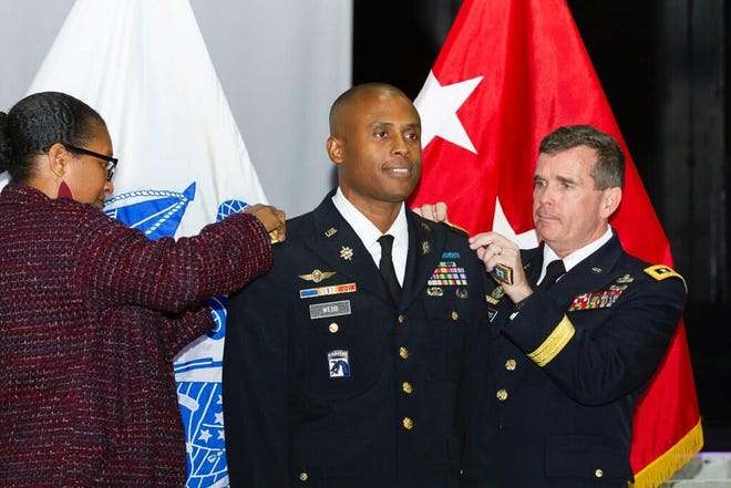 Maj. Webb is promoted by Lt. Gen. Seamands and Dr. Lita Powell, his aunt, at Metro Church, Washington, D.C., on Feb. 28, 2019.