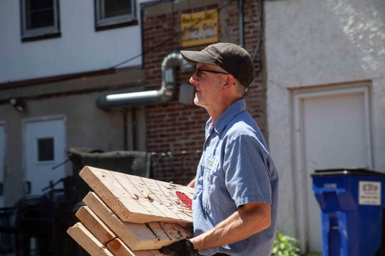 A crew from POET Biorefining - Chancellor and Mueller Pallets loaded up 6,000 wooden boards from Escape 605 in downtown Sioux Falls on May 16. The boards previously served as axe-throwing targets.