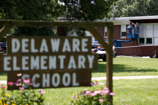 Construction workers prepare Delaware Elementary School for demolition on Tuesday.