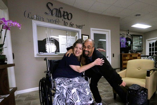 Illinois recently adopted recreational marijuana but has had medical dispensaries operating since 2015. In this Tuesday, Oct. 20, 2015 photo, Shamay Flaharty, of Lewiston, Ill., who has multiple sclerosis and is hoping cannabis will help ease her pain and headaches, hugs Eric Sweatt, partner and manager of Salveo Health and Wellness, a licensed medical cannabis dispensary, in Canton, Ill.