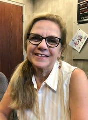 """Paula Ringer, a longtime member of the Midtown Ladies Victorian Drill Team,  calls the organized """"fan turn"""" similar to synchronized swimming."""