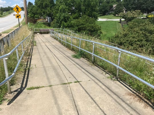 Years ago, there was a second drinking fountain along the South Creek Ozark Greenways trail, where it reached Battlefield Road. It was at the bottom of this terraced part of the trail.