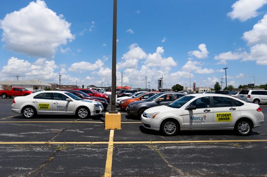 Mercy driver education cars sit in a parking lot at the Mercy Injury Prevention Center on West Battlefield Road on Tuesday, July 2, 2019. Mercy will end its 'in car' driver education program in mid-August.