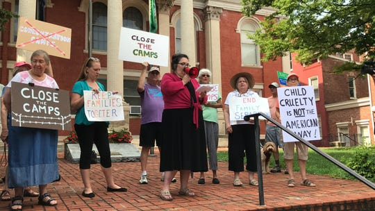 Stephanie Ward, center, speaks out about migrant detention border facilities' living conditions on Tuesday at the Augusta County Courthouse.