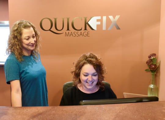 Massage therapist Rebecca Nielsen (left) and business owner Beth Huber talk about massage therapy training and regulations at Quick Fix Massage Shop in St. Cloud on June 24, 2019.